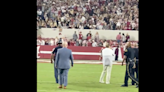 Alabama coach Nick Saban celebrates with student section after win over Tennessee