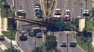 5 injured after a bridge collapses over DC highway