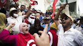Tunisian president vows new electoral code, transition team