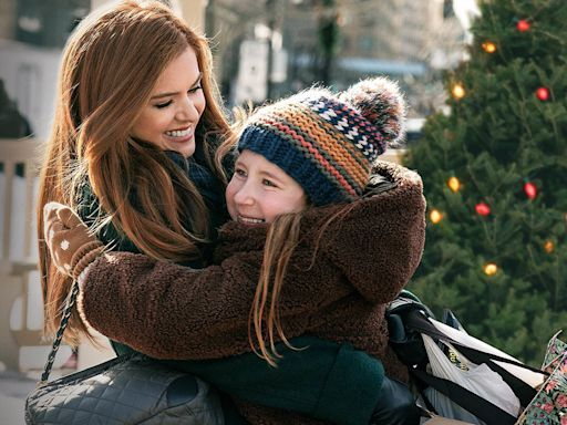 Isla Fisher calls out social media for 'threatening our planet and democracy' in advance of 'Godmothered' release on Disney Plus