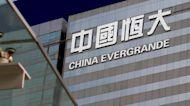Embattled Evergrande warns of default risks