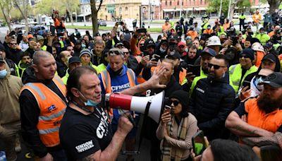 Melbourne police fire pepper balls, pellets to break up COVID-19 protest