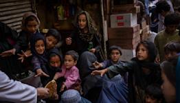 The Latest: Pakistan, Iran leaders meet on Afghanistan