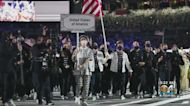Family Of Miami's Eddy Alvarez Watch Proudly As He Carries American Flag At Olympics Opening Ceremony
