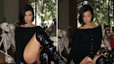 Kourtney shows off legs in bodysuit and boots & says she's 'queen of Halloween'