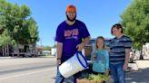 Volunteers help with Montpelier Beatification flower planting