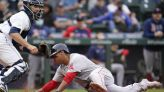 Schwarber, Vazquez power Red Sox past Mariners 9-4 in 10