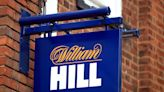 William Hill and Ladbrokes hit by betting shops closures