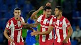 Luis Suarez hits late double as Atletico Madrid return to summit