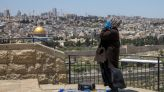 Muslims in Jerusalem pray outdoors amid virus lockdown