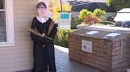 Scarecrow honoring Ruth Bader Ginsburg presiding over Kennebunk