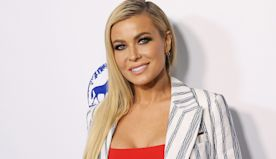 Carmen Electra poses in barely-there Playboy bunny Halloween costume