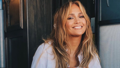 J.Lo Is Glowing in a White Blouse and Distressed Denim in the Dominican Republic
