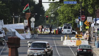 Crews work to reopen Floyd square, activists close it again