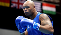 Frazer Clarke guaranteed a medal after opponent Mourad Aliev gets disqualified