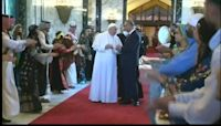 Iraqi dancers welcome a peace-seeking Pope Francis to Baghdad