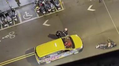 女友受驚!公館機車險撞小黃 騎士遭按喇叭攔車推人