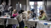 Hundreds of D.C. poll workers affected by payment delays are starting to receive their checks