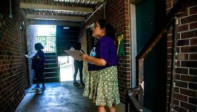 In Southeast Raleigh, volunteers go door to door — and car to car — to promote vaccines