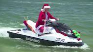Santas ditch sleighs for jet skis in Australia