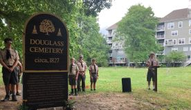 Boy Scout gets troop to help restore historic black cemetery
