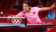 Olympics-Table Tennis-Chinese paddlers Chen, Fan advance to semi-final