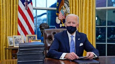 Biden makes symbolic changes to Oval Office reflecting goals as president