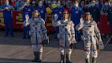China launches three-man crew to new space station