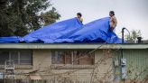Nicholas lingers in Louisiana, dumps rain as far as Florida