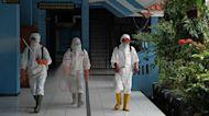 Indonesia May Begin Easing Virus Curbs as Covid Deaths Soar