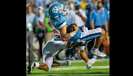 UVA safety won't face league discipline after dirty hit on UNC's Josh Downs