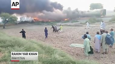 Fire on moving train kills dozens in Pakistan