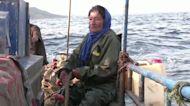 A Tunisian fisherwoman and her companion: the sea