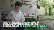 Mom teaches her toddler how to use a stove