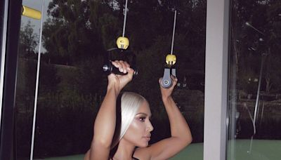 Kim Kardashian Rocks Icy Blonde Hair as She Works Out in a Revealing Black Swimsuit