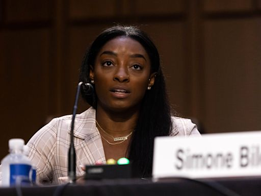 Simone Biles stiff arms USA Gymnastics