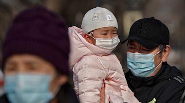 The Latest: Shanghai locks down 2 major hospitals over cases