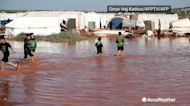 Winter rains flood camp for displaced in Syria
