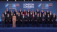 'Brain dead' NATO pulls off summit despite insults