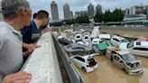 Deaths in flooded subway as torrential rain hits central China