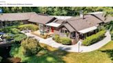 Sprawling log home with its own 1800's western town lists in Washington. Take a look