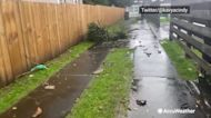 Suspected tornado scatters debris across New Zealand neighborhood