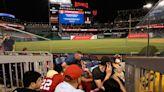 Four hurt after gunfire erupts outside stadium as terrified attendees hide