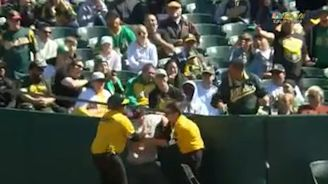 A's security, umpire Jeff Nelson apprehend fans who try to interrupt game