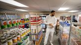 Utah Jazz's Rudy Gobert helps open a food pantry at a Salt Lake City middle school