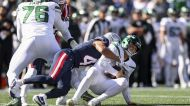Jets' Zach Wilson knocked out of game with knee injury