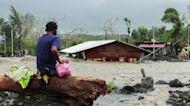 At least 10 dead as typhoon slams Philippines