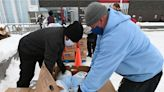 Thanksgiving meal distributions in Anchorage this year are marked by long lines and COVID-19 precautions