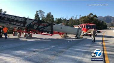 Overturned big rig with crane shuts down lanes on EB 210 Freeway in La Canada Flintridge