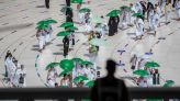 The Latest: Saudi Arabia will reopen to tourists on Sunday